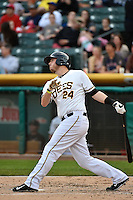 C.J. Cron (24) of the Salt Lake Bees at bat against the Albuquerque Isotopes at Smith's Ballpark on April 21, 2014 in Salt Lake City, Utah.  (Stephen Smith/Four Seam Images)