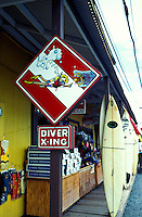 A humorous Diver Crossing Sign welcomes shoppers at the entrance to the  See and Sea store in the town of Haleiwa. This popular store offers a wide variety of items for the ocean sports enthusiast. Located along the north shore of oahu.