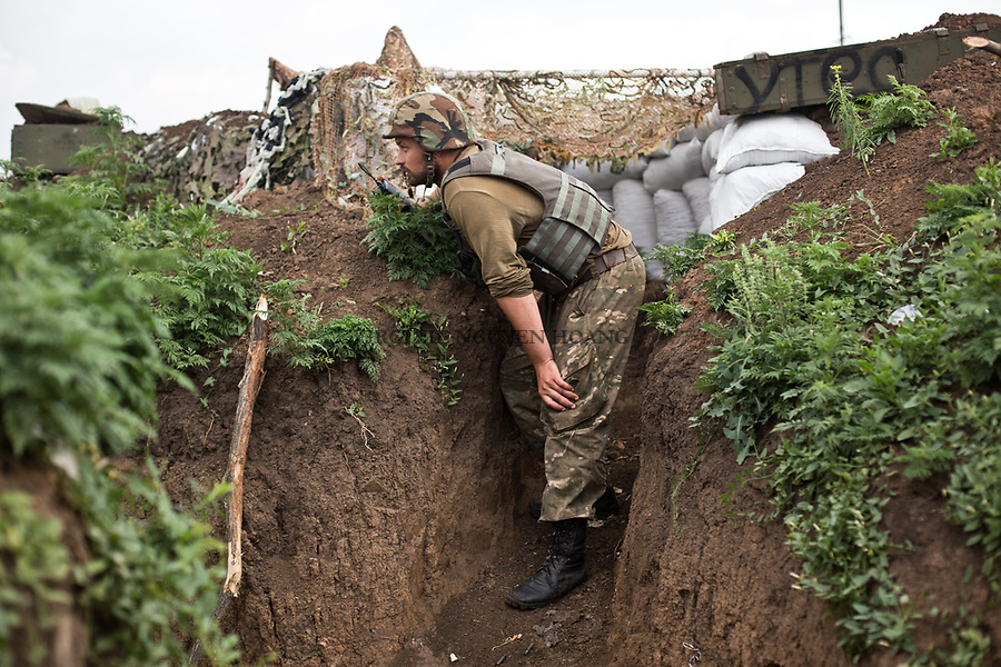 UKRAINE, Shyrokyne: Nekratov is coordinating a counter offensive from in the trenches of the first line of defense in Shyrokyne.