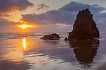 Ecola State Park, Oregon<br /> Sunset reflections and silhouetted seastacks on Indian Beach