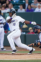 Courtney Hawkins (10) of the Winston-Salem Dash follows through on his swing against the Wilmington Blue Rocks at BB&T Ballpark on April 3, 2014 in Winston-Salem, North Carolina.  The Blue Rocks defeated the Dash 3-1.  (Brian Westerholt/Four Seam Images)