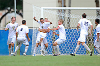 2 October 2011:  FIU's team (pictured, Anthony Hobbs (16), Nicholas Chase (8), Quentin Albrecht (22, hugging De Sousa), John Kite (15)), celebrates an overtime goal by Roberto De Sousa (20, center) as the FIU Golden Panthers defeated the University of Kentucky Wildcats, 1-0 in overtime, at University Park Stadium in Miami, Florida.