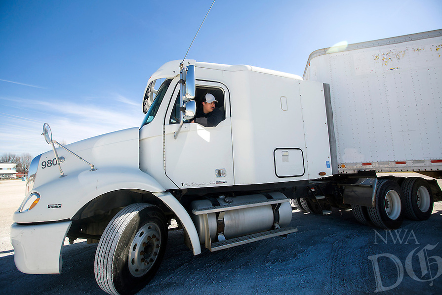 NWA Democrat-Gazette/JASON IVESTER<br /> Diego Nava of Bethel Heights checks his location while reversing on a course Wednesday, March 1, 2017, during the CDL class at Northwest Technical Institute in Springdale.