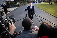 US President Donald J. Trump delivers remarks as he walks to board Marine One on the South Lawn of the White House  in Washington DC, USA, 02 December 2017. President Trump commented on the tax reform package passed by the Senate and on the guilty plea by former National Security Advisor Michael Flynn.<br /> Credit: Shawn Thew / Pool via CNP /MediaPunch