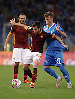 Calcio, Serie A: Roma vs Empoli. Roma, stadio Olimpico, 17 ottobre 2017.<br /> Roma's Miralem Pjanic is challenged by Empoli's Marcel Buchel, right, during the Italian Serie A football match between Roma and Empoli at Rome's Olympic stadium, 17 October 2015.<br /> UPDATE IMAGES PRESS/Isabella Bonotto