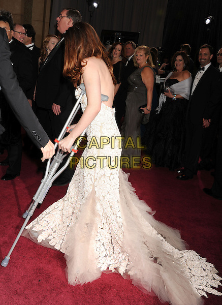 Kristen Stewart (wearing Reem Acra).85th Annual Academy Awards held at the Dolby Theatre at Hollywood & Highland Center, Hollywood, California, USA..February 24th, 2013.oscars full length white strapless dress sheer tulle detail lace side profile crutches injury wound .CAP/ROT/TM.©Tony Michaels/Roth Stock/Capital Pictures