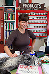 "Naomi's Organic Farm Supply is a family-owned shop with a wide range of organic products including: soil amendments and fertilizer, seeds, straw, hay, compost, potting soils, livestock feeds, salts, supplements, chicken supplies, pet foods, hand tools & lots of books.  Naomi with one of the store cats named, ""Jeff"""