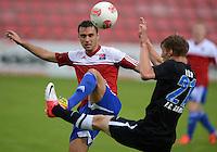 3. Fussball Bundesliga:  2. Spieltag    Saison   2012/2013   SpVgg Unterhaching  - FC Hansa Rostock   28.07.2012 Yasin Yilmaz (li, Unterhaching) gegen Michael Blum (FC Hansa Rostock)