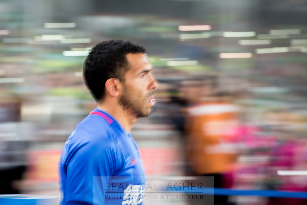 Carlos Tevez of Chinese football Super League team Shanghai Shenhua walks out before the game with Beijing Guo'an at the Worker's stadium in Beijing. 2nd April, 2017.