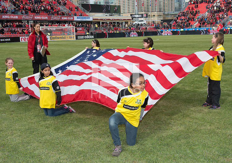06 April 2013: The young escorts hold the American flag during the national anthems in an MLS game between FC Dallas and Toronto FC at BMO Field in Toronto, Ontario Canada..The game ended in a 2-2 draw..