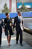 On the 10th anniversary of the September 11th attacks, First Lady Michelle Obama and United States President Barack Obama at the North Pool at the September 11th Memorial at the World Trade Center site in New York, New York on September 11, 2011..Credit: Jefferson Siegel / Pool via CNP