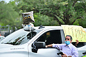 PEMBROKE PINES, FL - MAY 15: A parent waits in the parking lot at Pembroke Pines Charter High School on May 15, 2020 in Pembroke Pines, Florida. Because of social distancing mandates instituted by the state to curtail the spread of COVID-19, the 2020 graduates received their diplomas in a near-empty auditorium with no friends, family or relatives allowed to attend. A video of each student walking the stage to receive their diploma will be streamed on the school's scheduled graduation date of May 29.  ( Photo by Johnny Louis / jlnphotography.com )