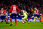 Lionel Messi of FC Barcelona (C) dribbles Saul Niguez of Atletico de Madrid (R) during the La Liga 2018-19 match between Atletico Madrid and FC Barcelona at Wanda Metropolitano on November 24 2018 in Madrid, Spain. Photo by Diego Souto / Power Sport Images