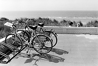 Netherlands. North Holland Region. Zandvoort. Couple and bicycles. Zandvoort has a long sandy beach on the North Sea and is one of the major beach resorts of the Netherlands. Royal Dutch Gazelle is the only Dutch bicycle manufacturer. and produces more than 300,000 bicycles a year. Gazelle is market leader in the Netherlands.  © 1995  Didier Ruef