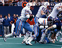 .Houston Oilers Earl Campbell(34) during a game against the New York Giants on December 5, 1982 at Giants Stadium in East Rutherford, New Jersey. The Giants beat the Oilers 17-14. Earl Campbell played 7 years with 2 different teams  He was a 5-time Pro Bowler, 3-time first team Pro Bowler and was inducted to the Pro Football Hall of Fame in 1991.