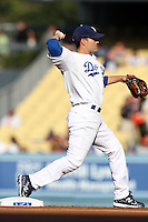 Jamey Carroll #14 of the Los Angeles Dodgers throws to first base during game against the San Francisco Giants at Dodger Stadium in Los Angeles,California on April 3, 2011. Photo by Larry Goren/Four Seam Images