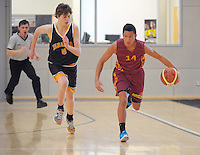 Action from the match between Taranaki and Rotorua (maroon) boys during the national under-15 basketball championship at the ASB Sports Centre, Kilbirnie, Wellington, New Zealand on Thursday, 25 July 2013. Photo: Dave Lintott / lintottphoto.co.nz