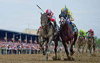 BALTIMORE, MD - MAY 20: Cloud Computing #2 (red cap), ridden by Javier Castellano, outduels Classic Empire #5, ridden Julien Leparoux, to win the Preakness Stakes on Preakness Stakes Day at Pimlico Race Course on May 20, 2017 in Baltimore, Maryland.(Photo by Alex Evers/Eclipse Sportswire/Getty Images)