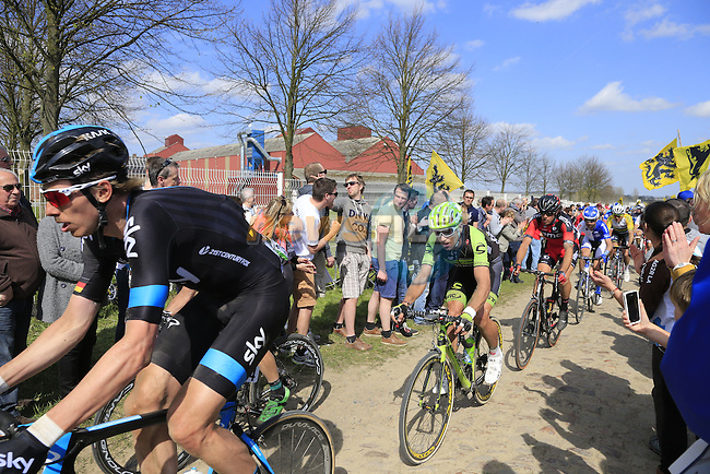 The peloton including Christian Knees 9GER) Team Sky tackle Sector 10 Mons-en-Pevele during the 113th edition of the Paris-Roubaix 2015 cycle race held over the cobbled roads of Northern France. 12th April 2015.<br /> Photo: Eoin Clarke www.newsfile.ie