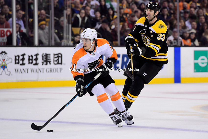 March 8, 2018: Philadelphia Flyers center Travis Konecny (11) plays the puck in his offensive zone during the NHL game between the Philadelphia Flyers and the Boston Bruins held at TD Garden, in Boston, Mass. Boston defeats Philadelphia 3-2 in regulation time. Eric Canha/CSM