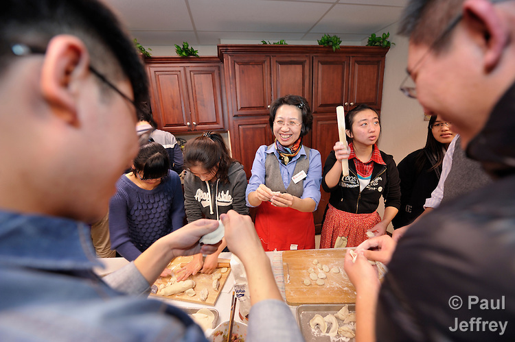 The Rev. Fuxia Wang (center) is a United Methodist missionary, serving as a church and community worker on the staff of the Wesley Center at the University of Oklahoma in Norman, where she works with international students. Here she makes Chinese dumplings with students for a celebration of the Chinese New Year.