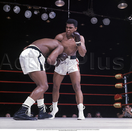 1964. Miami, Florida. CASSIUS CLAY, right, battles Sonny Liston for the world heavyweight championship at the Miami Beach Convention Hall in Miami, Florida . Muhammad Ali died on June 3rd 2016 of a respiratory complication in a Phoenix hospital.