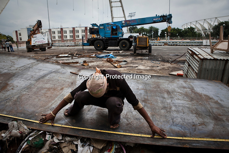 Indian labourers work outside of the main stadium for the approaching 19th Commonwealth Games 2010 Delhi at Jawaharlal Nehru Stadium in New Delhi, India. The under construction footbridge collapsed on Sept 21st, 2010 injuring 27 workers at the main stadium for the upcoming Commonwealth Games.