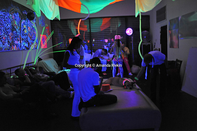 Revelers hang out in a lounge at the Black and Light Ball on the Bowery in Lower Manhattan in New York, New York on May 9, 2009.