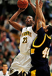 13 December 2009: University of Vermont Catamounts' forward Marqus Blakely, a Senior from Metuchen, NJ, goes up for two points against the Quinnipiac University Bobcats at Patrick Gymnasium in Burlington, Vermont. Blakely scored a career-high 32-point game as the Catamounts defeated the visiting Bobcats 80-77 to mark the Cats' season home opener with a win. Mandatory Credit: Ed Wolfstein Photo