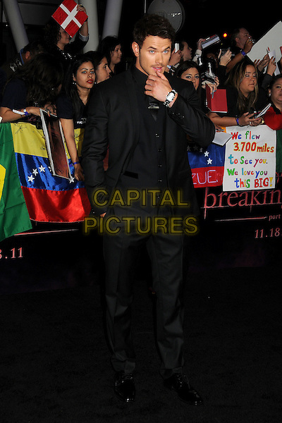 Kellan Lutz  .The Los Angeles premiere of 'The Twilight Saga Breaking Dawn Part 1' at Nokia Theatre at L.A. Live in Los Angeles, California, USA..November 14th, 2011.full length black suit waistcoat hand arm.CAP/ADM/BP.©Byron Purvis/AdMedia/Capital Pictures.