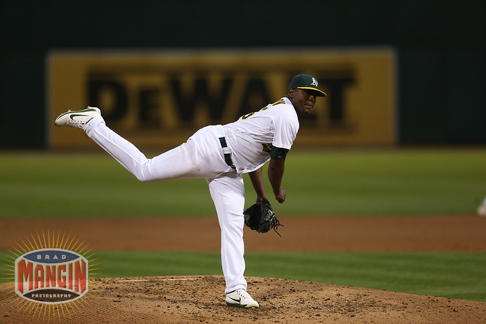 OAKLAND, CA - AUGUST 14:  Jharel Cotton #45 of the Oakland Athletics pitches against the Kansas City Royals during the game at the Oakland Coliseum on Monday, August 14, 2017 in Oakland, California. (Photo by Brad Mangin)