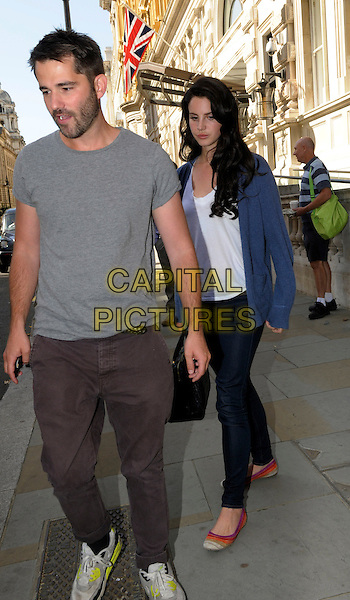 Lana Del Rey leaving her hotel in central London, England..5th September 2012.full length blue cardigan white top jeans denim black bag purse black hair grey gray t-shirt friend stubble facial hair .CAP/IA.©Ian Allis/Capital Pictures.