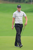 Danny Willett (ENG) on the 3rd green during Thursday's Round 1 of the 2014 BMW Masters held at Lake Malaren, Shanghai, China 30th October 2014.<br /> Picture: Eoin Clarke www.golffile.ie