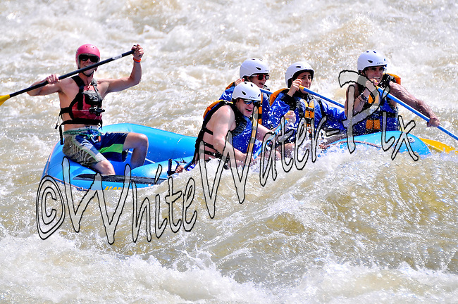 Nova Guides crashing Man-Eater Rapid while running while running Shoshone in Glenwood Canyon on the Colorado River on the morning of July 19, 2014.