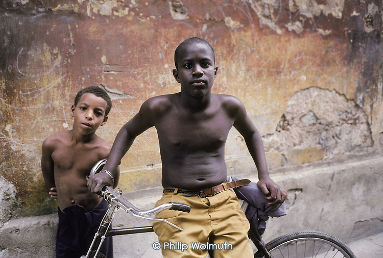 Two boys with a Chinese-made bicycle in one of the crumbling streets of Old Havana (Havana Viejo).
