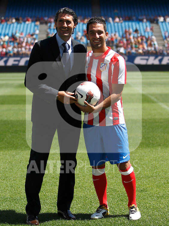Atletico de Madrid's new player Arda Turan (r) during his official presentation with the General Manager Jose Luis Perez Caminero. August 16, 2011. (ALTERPHOTOS/B.Echavarri)