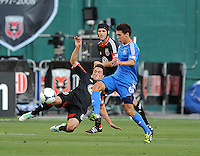 John Thorrington (8) of D.C. United goes against Shea Salinas (6) of the San Jose Earthquakes.  D.C. United defeated the San Jose Earthquakes 1-0, at RFK Stadium, Saturday June 22 , 2013.