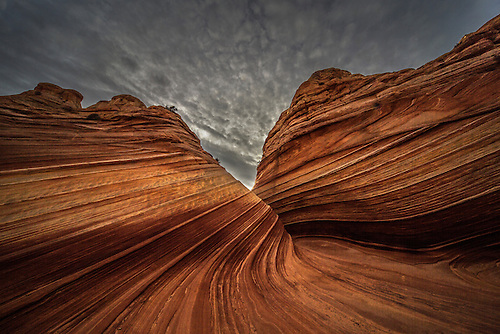 Unusual sandstone rock formations resembling waves make up the landscape at The Wave at North Coyote Buttes on the Utah/Arizona border