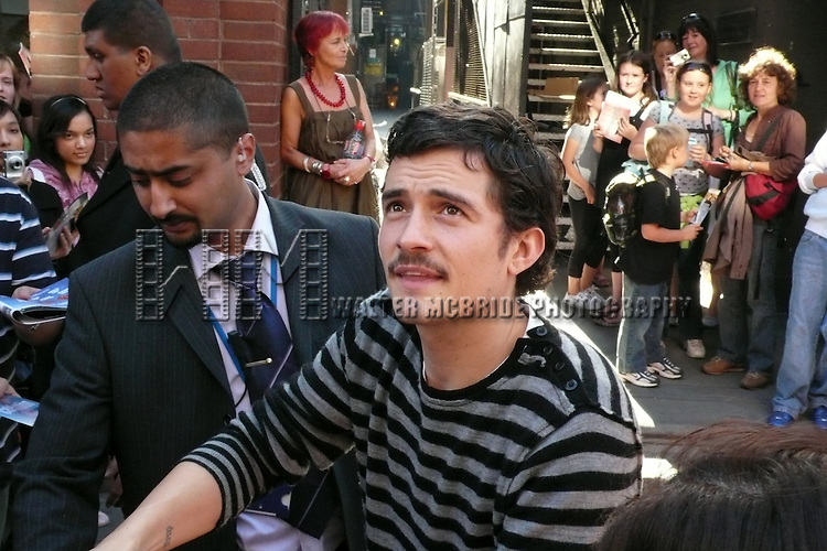 Orlando Bloom.greeting  his fans and signing autographs  after a performance  in the David Story play, IN CELEBRATION at he Duke of Yorks Theatre in London..© Walter McBride /