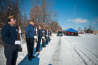An American Legion Honor Guards stands ready at the funeral of a World War II veteran being laid to rest at a cemetery in Westerville, Ohio. The local American Legion travels to perform the ceremony whenever requested and has traveled to adjoining states to assist other groups with their needs.
