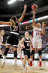 SIOUX FALLS, SD: MARCH 5: Madison McKeever #23 from the University of South Dakota lays the ball up past Abi Lujan #21 from Nebraska Omaha during the Summit League Basketball Championship on March 5, 2017 at the Denny Sanford Premier Center in Sioux Falls, SD. (Photo by Dave Eggen/Inertia)