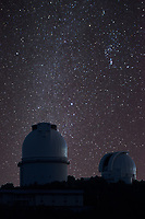 Dark skies over the McDonald Observatory with two of it telescope domes against a sky full of stars.   This area of west Texas in the Davis mountains  is know for having some of the darkest skies around.  This image may print slightly darker than seen.