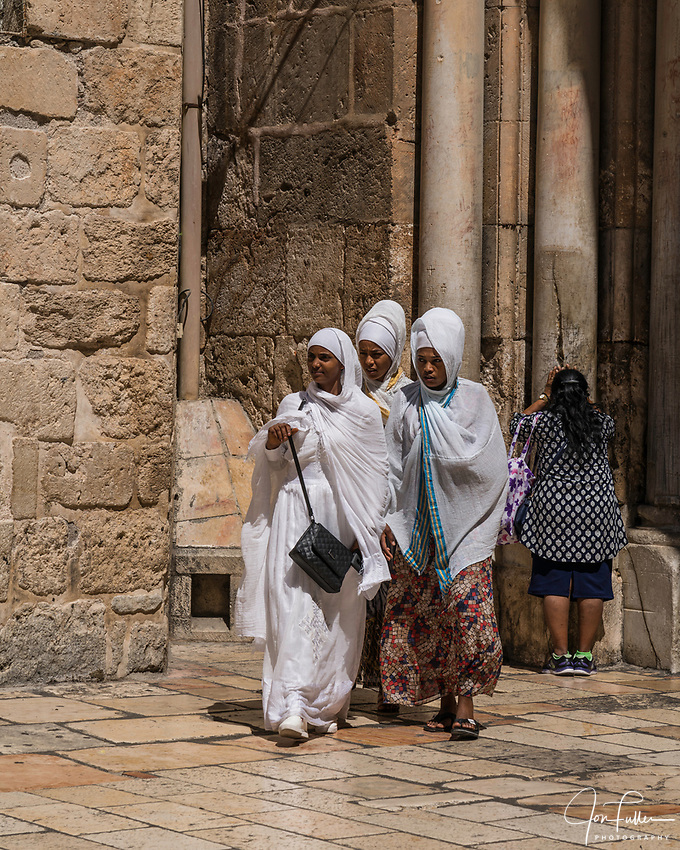 Ethiopian Christian pilgrims visiting the Church of the Holy Sepulchre in the Christian Quarter of the Old City of Jerusalem.  The Old City of Jerusalem and its Walls is a UNESCO World Heritage Site.  This church was built over the site believed by many to be location of the death and burial of Jesus Christ.