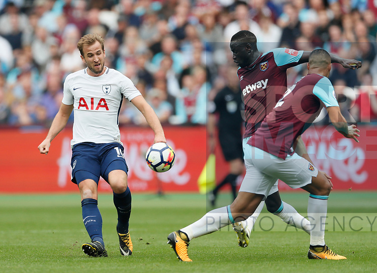 West Ham's Chiekhou Kouyate tussles with Tottenham's Harry Kane during the premier league match at the London Stadium, London. Picture date 23rd September 2017. Picture credit should read: David Klein/Sportimage
