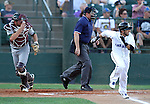 SIOUX FALLS, SD - JULY 18:  Cory Morales #5 from the Sioux Falls Canaries scampers to first in the first inning as catcher Ryan Babineau #2 from the Gary South Shore Rail Cats runs to back up the play Thursday evening at the Sioux Falls Stadium. (Photo by Dave Eggen/Inertia)