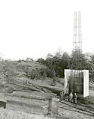 Doctor Robert H. Goddard's tower and shelter at the Army artillery range at Camp Devens, in Ayer, Massachusetts in the winter of 1929-1930. Goddard originally began testing rockets on his aunt's farm in Auburn, Massachusetts until the local police, fire department and townspeople became concerned about the noise and menace to the public the rockets created. Although Goddard maintained that the rockets were not a danger, he soon moved to Camp Devens, Massachusetts. There he was able to launch the rockets without attracting attention. .Credit: NASA via CNP
