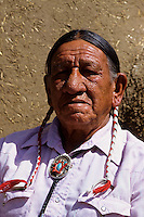 Portrait of a Taos Pueblo Indian man with braises in New Mexico, USA
