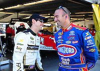 Feb 07, 2009; Daytona Beach, FL, USA; NASCAR Sprint Cup Series driver Kelly Bires (left) talks with Marcos Ambrose during practice for the Daytona 500 at Daytona International Speedway. Mandatory Credit: Mark J. Rebilas-