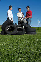John Stier, associate professor of horticulture (L), Jim Park, professor of civil and environmental engineering (center) and Bob Lisi, graduate student in civil and environmental engineering (R), hold a bucket of shredded tire chips at the University Ridge golf course, adjacent to the O.J. Noer Turfgrass Research Facility where they have conducted research on the impact of fertilizers and pesticides. The researchers found that shredded tires placed beneath golf course greens can absorb excess nitrates and other chemicals from fertilizers.<br /> <br /> Client: University of Wisconsin-Madison<br /> &copy; UW-Madison University Communications 608-262-0067<br /> Photo by: Michael Forster Rothbart<br /> Date:  9/03    File#:   D100 digital camera frame 10175.