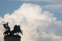 A statue is silhouetted in front of summer clouds in Budapest, Hungary on Aug. 1, 2018. ATTILA VOLGYI